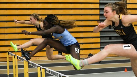 Juru Okwaramoi (middle) hurdles at the Panther Tune-Up at UW-Milwaukee Feb. 14. (Photo courtesy of Marquette Athletics.)