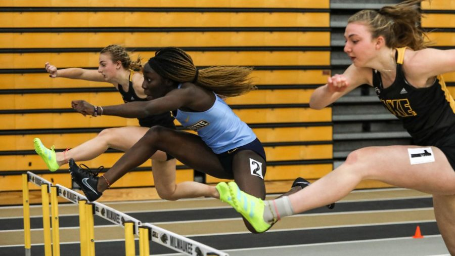 Juru+Okwaramoi+%28middle%29+hurdles+at+the+Panther+Tune-Up+at+UW-Milwaukee+Feb.+14.+%28Photo+courtesy+of+Marquette+Athletics.%29