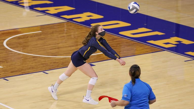 The Golden Eagles fought hard in four sets to win their first match of the weekend (Photo Courtesy of Marquette Athletics).
