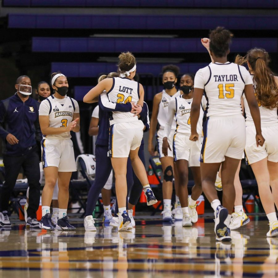 Marquette players embrace after their blowout win over Butler 77-48 (Courtesy of Marquette Athletics)