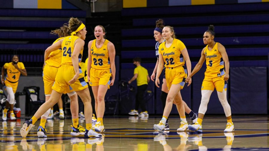 Marquette women's basketball celebrates during their 65-57 win over Villanova on Feb. 19 2021. (Photo courtesy of Marquette Athletics.)