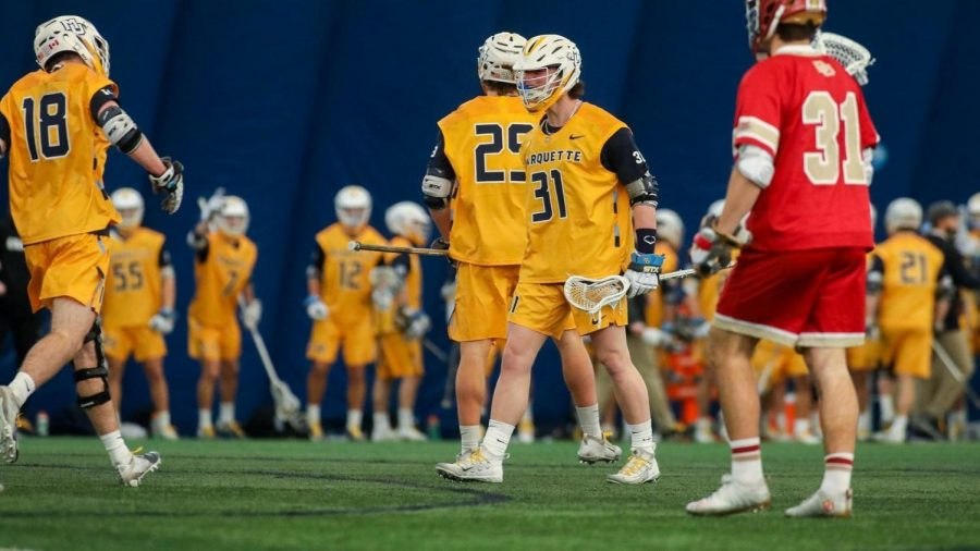 First-year attacker Russell Melendez (31) and redshirt junior attacker Griffin Fleming (18) look to celebrate during Marquette's game against Denver on Saturday afternoon (Photo courtesy of Marquette Athletics.)