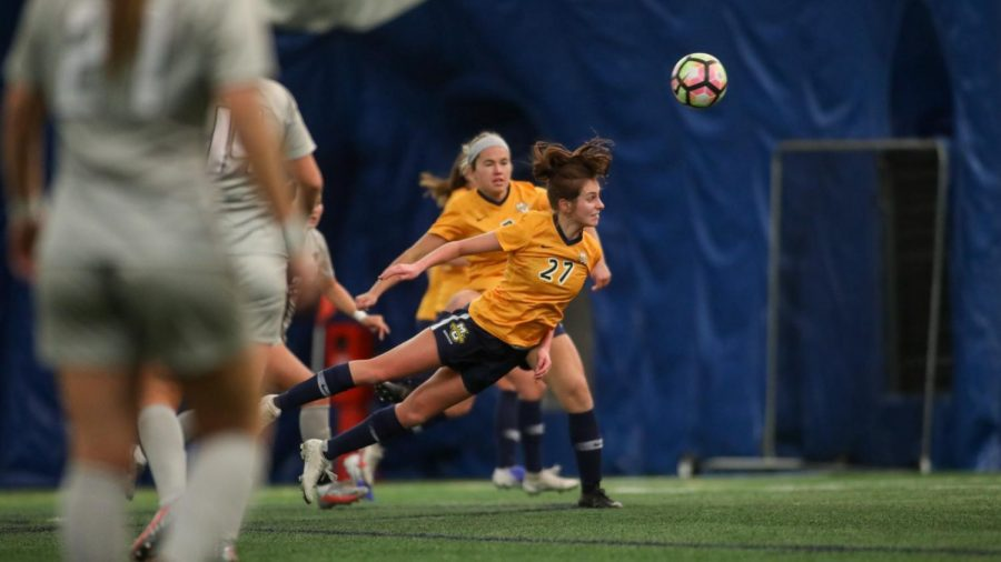 Meredith McGuire heads a ball during Marquette's 5-0 win over Chicago State (Courtesy of Marquette Athletics)