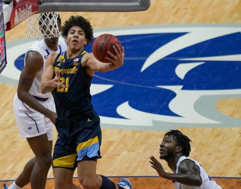 Sophomore guard D.J. Carton (21) puts up a layup against the Seton Hall Pirates on Sunday afternoon (Photo courtesy of Marquette Athletics.)