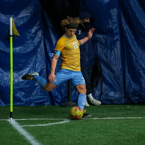 Redshirt junior midfielder Zak Wegner kicks the ball from the corner (Photo courtesy of Marquette Athletics.)