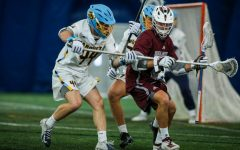 Defenseman P.J. Cox fights for the ball in a game last season against Bellarmine University (Photo courtesy of Marquette Athletics.)