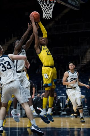 Jamal Cain fights for the rebound with Butler