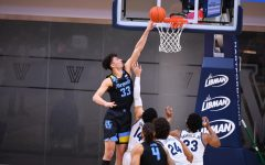 First-year forward Dawson Garcia (33) goes up for a putback basket against the Villanova Wildcats on Wednesday night. He had a career-high 28 points (Photo courtesy of Marquette Athletics.)