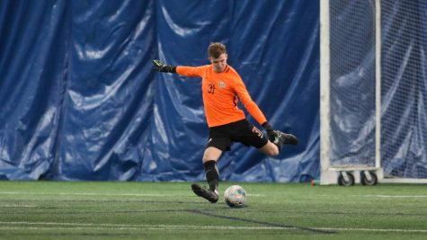 Redshirt sophomore goalkeeper Chandler Hallwood kicks from goal in a match against Loyola Chicago on Feb. 3 (Photo courtesy of Marquette Athletics.)