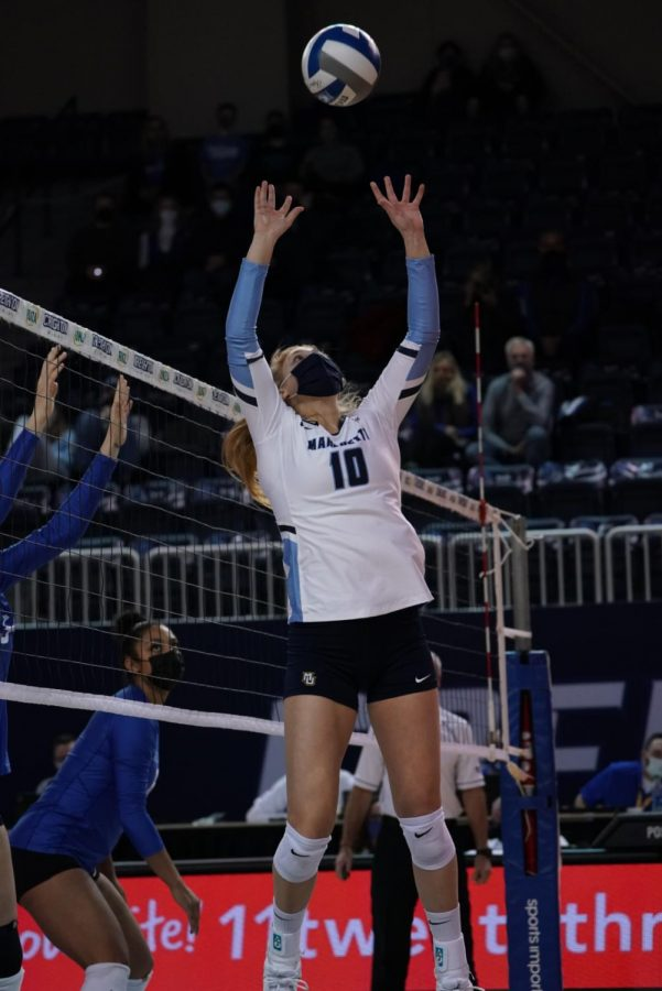 Taylor Wolf (10) sets it up in Marquettes win over Creighton. (Photo courtesy of Marquette Athletics.)