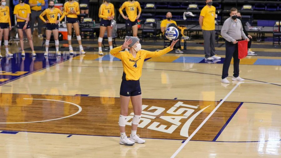Sarah Rose (4) opens the match with a service ace. (Photo courtesy of Marquette Athletics.)