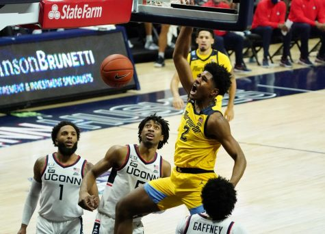 First-year forward Justin Lewis (2) throws home a dunk against the UConn Huskies on Saturday afternoon (Photo courtesy of Marquette Athletics.)