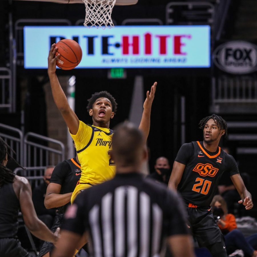 First-year forward Justin Lewis goes up for a layup against Oklahoma State back on Dec. 1. Lewis had a career-high 13 rebounds in 22 minutes against the Cowboys (Photo courtesy of Marquette Athletics.)