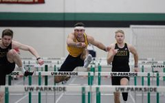Sophomore Mitchell Van Vooren hurdles a gate during the Parkside Triangular meet on Feb. 6 (Photo courtesy of Marquette Athletics.)