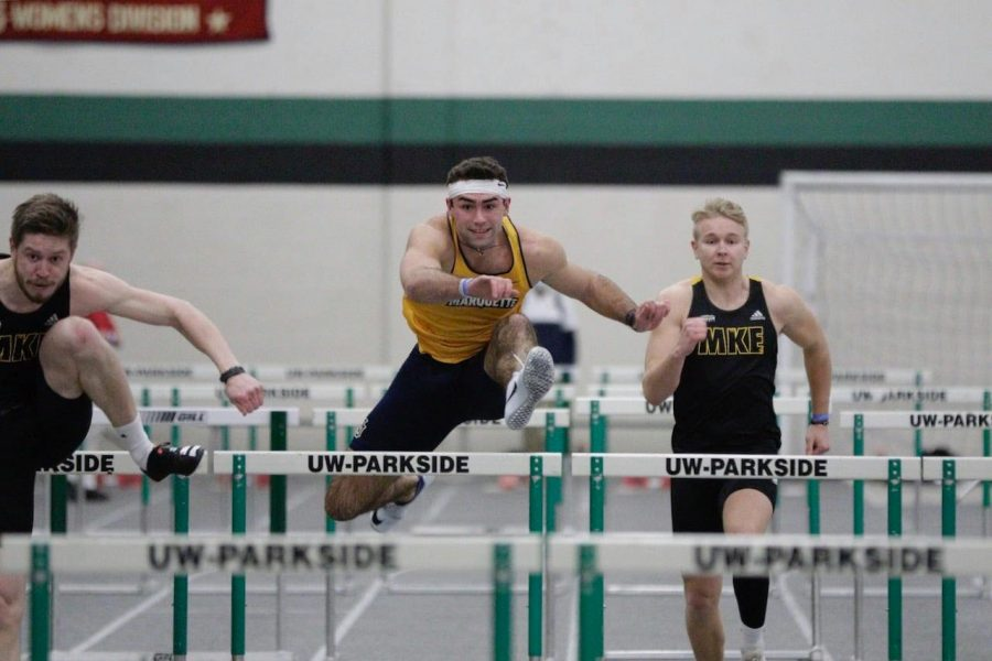 Sophomore+Mitchell+Van+Vooren+hurdles+a+gate+during+the+Parkside+Triangular+meet+on+Feb.+6+%28Photo+courtesy+of+Marquette+Athletics.%29