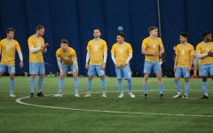 The Marquette men's soccer team lines up before their game against Loyola Chicago Feb. 3 (Photo courtesy of Marquette Athletics.)