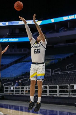 Junior guard Jose Perez (55) attempts a 3-point shot against the Creighton Bluejays on Feb. 2 (Photo courtesy of Marquette Athletics.)