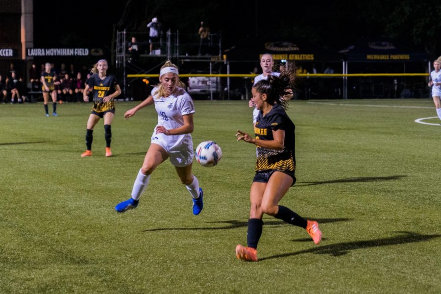Then-first-year midfielder/forward Alex Campana (19) tracks down the ball in Marquette's match against UWM last season.