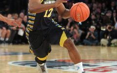 Derrick Wilson drives the ball down the court in a Marquette game March 12, 2015. Photo courtesy Marquette Athletics.