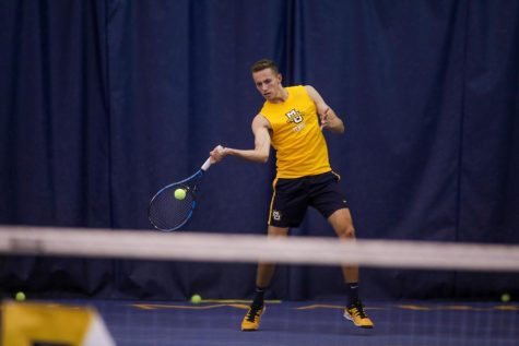 Julian Robinson hits a forehand during practice Nov. 5, 2019. (Photo courtesy of Marquette Athletics.)
