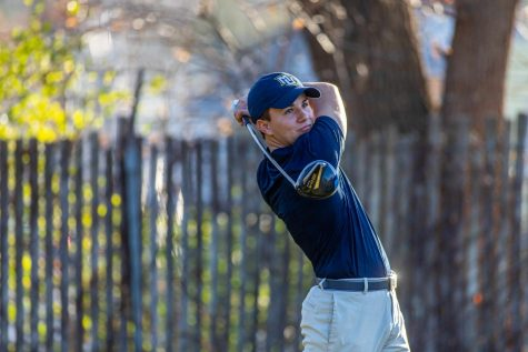 Josh Robinson follows through on his swing. (Photo courtesy of Marquette Athletics.)
