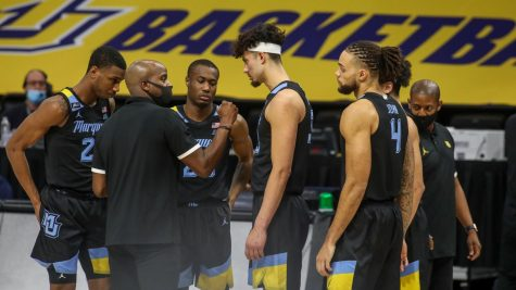 Killings coaches Jamal Cain, Koby McEwen, Dawson Garcia and Theo John during practice Jan. 5. (Photo courtesy of Marquette Athletics.)