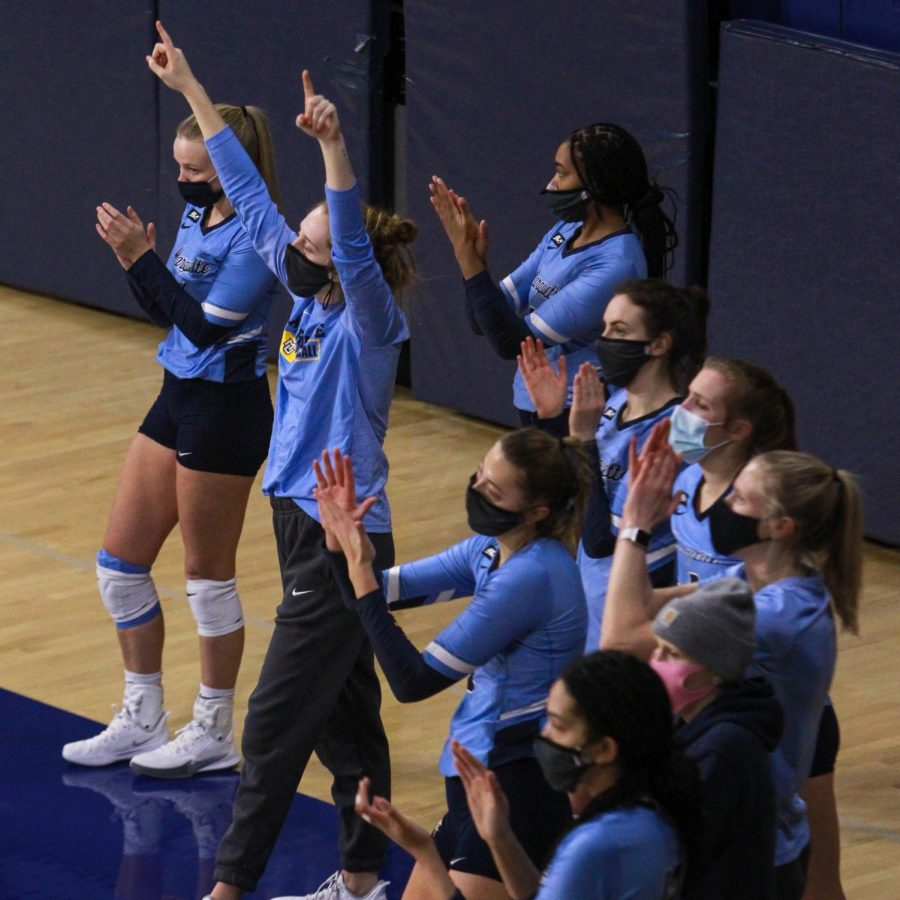 Ella Foti (arms up) celebrates with her teammates in Marquette's sweep over DePaul Feb. 12. (Photo courtesy of Marquette Athletics.)