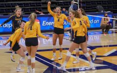 The women's volleyball team celebrates in the team's win over Iowa State Feb. 27. (Photo courtesy of Marquette Athletics.)
