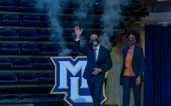 Shaka Smart and his wife Maya walk into his introductory press conference March 29 in the Al McGuire Center. (Photo courtesy of Marquette Athletics.)