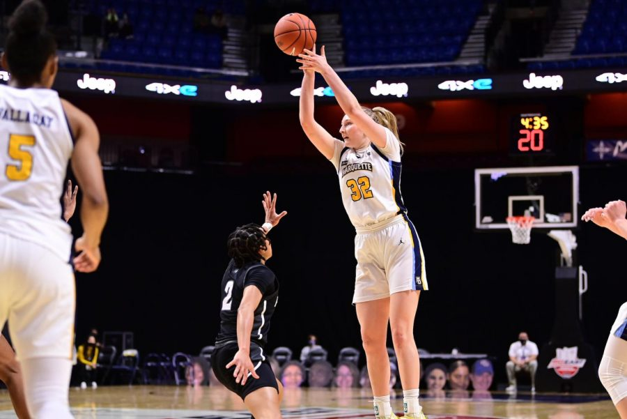 First-year forward Liza Karlen shoots a jumper in Marquette's win over Providence on Saturday evening (Photo courtesy of Marquette Athletics.)
