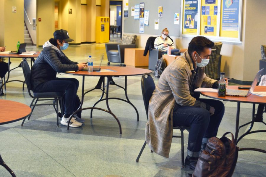 Students study at tables in the Alumni Memorial Union, following Marquette's social distancing guidelines.