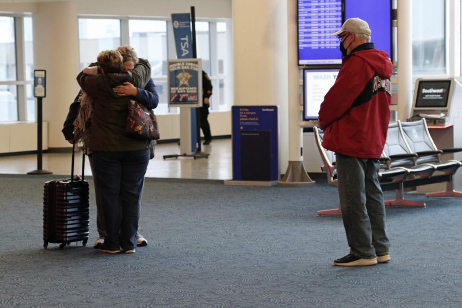 Travelers greet loved ones at Milwaukee General Mitchell Airport.