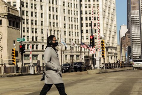 A pedestrian walks down a street in Chicago.