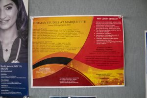 A German courses is posted outside of a classroom in Lalumiere Hall.