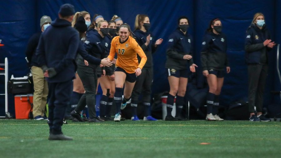 Elaina Eckert (17) being introduced during the starting lineup ahead of Marquette's 3-2 win over Illinois State Feb. 7. (Photo courtesy of Marquette Athletics.)