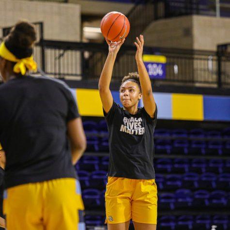 Julianna Okosun takes a shot during a pre-game warmup. Photo courtesy Marquette Athletics.