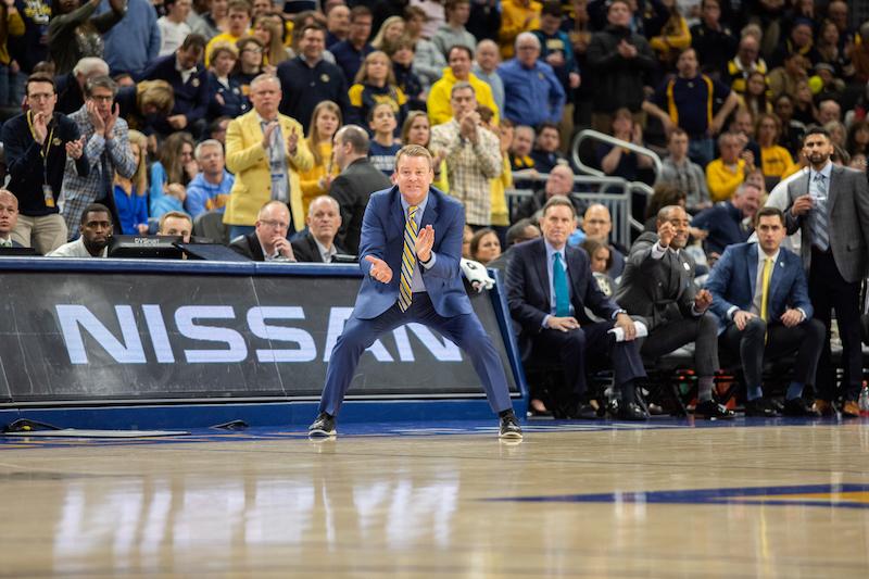 Steve Wojciechowski coaches from the sidelines.