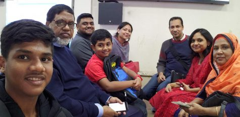 Romael Haque (third from left) smiles with his family in January 2020. Photo courtesy Romael Haque.