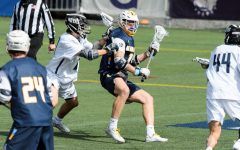 Garret Moya (19) works against a Georgetown defender in Marquette's 20-13 loss to the Hoyas on Saturday morning (Photo courtesy of Marquette Athletics.)
