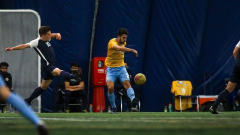 Junior midfielder Zyan Andrade kicks the ball past a Xavier defender on March 17. He scored the Golden Goal on Saturday afternoon against the Creighton Bluejays to give Marquette its sixth win of the season (Photo courtesy of Marquette Athletics.)