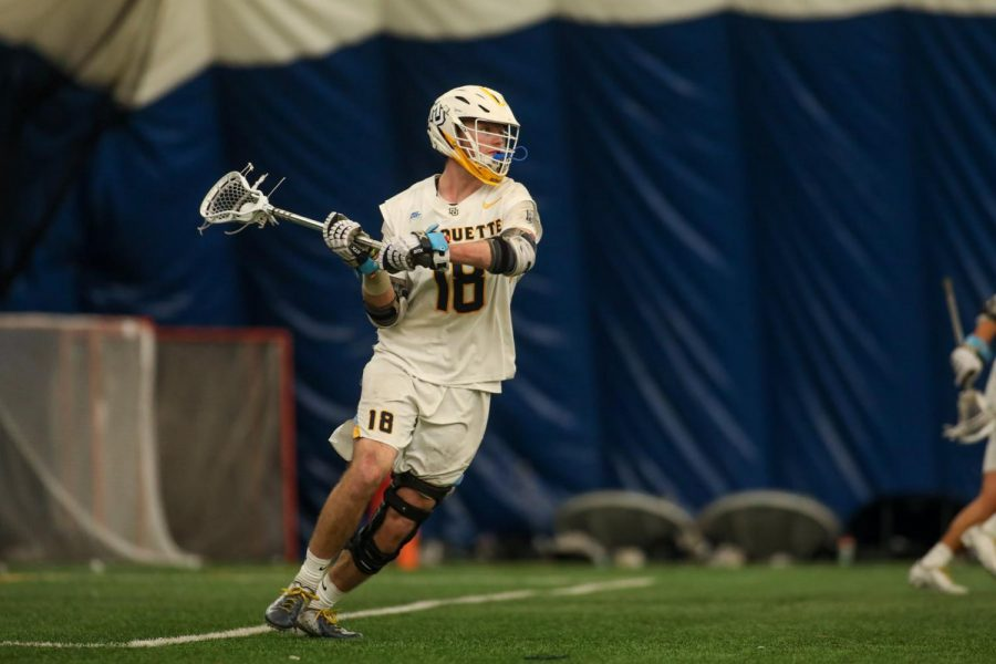 Redshirt junior attacker Griffin Fleming (18) gets ready to take a shot during a game against Providence March 13 (Photo courtesy of Marquette Athletics.)