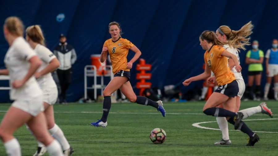 Kylie Sprecher (8) and Rachel Johnson (23) run after the ball in Marquette's win over Xavier. (Photo courtesy of Marquette Athletics.)