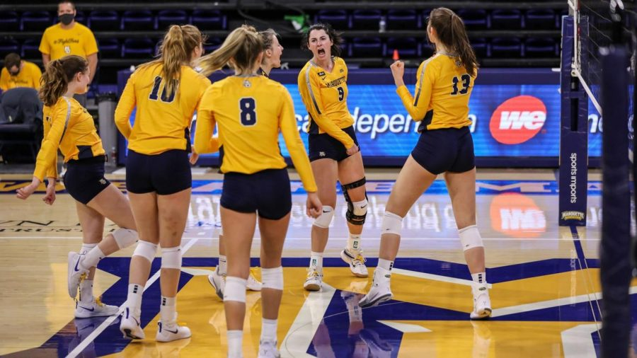 Senior outside hitter Kaitlyn Lines (9) and her teammates celebrate during the squad's sweep of Butler on Saturday afternoon (Photo courtesy of Marquette Athletics.)