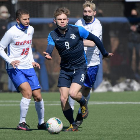 Junior forward Lukas Sunesson (9) strides past two DePaul defenders March 6 (Photo courtesy of Marquette Athletics.)