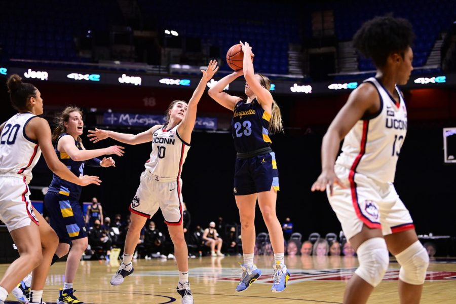 Jordan King (23) shoots. against UConn in Marquette's loss in the BIG EAST Tournament Final March 8. (Photo courtesy of Marquette Athletics.)