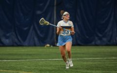 Senior defender Erin Dowdle (33) looks to make a play downfield (Photo courtesy of Marquette Athletics.)