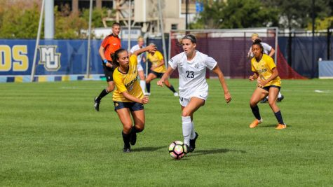 Rachel Johnson (23) dribbles the ball in Marquette