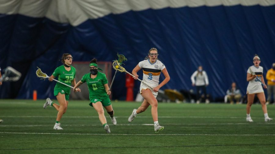 Leigh Steiner (3) runs with the ball in her crosse during Marquette's 16-4 win over University of Oregon Feb. 26. (Photo courtesy of Marquette  Athletics.)