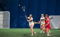 Emma Soccodato (10) passes the ball in Marquette's game against Louisville March 14. (Photo courtesy of Marquette Athletics.)