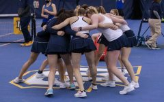 The Marquette women's tennis team huddles before the team's 3-4 loss to Drake March 27. (Photo courtesy of Marquette Athletics.)